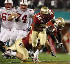 Florida State linebacker Dakoda Watson (36) picks up a fumble by Wisconsin quarterback Dustin Sherer and returns it 51 yards for a touchdown during the fourth quarter of the Seminoles' 42-13 victory over Wisconsin in the Champs Sports Bowl in Orlando.