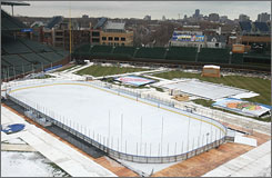 Preparations continue Saturday as crews work to turn Chicago's Wrigley Field from a baseball park to an outdoor hockey arena for the Jan. 1 game between the Blackhawks and the Detroit Red Wings.