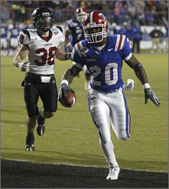 Louisiana Tech running back Daniel Porter runs in for an 11-yard touchdown against Northern Illinois during the second half of the Independence Bowl in Shreveport, La.