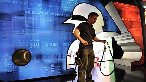 Tim Polese gathers up cables in Studio 3 at MLB Network after a rehearsal. The studio, which takes its number from Babe Ruth, features 62 video displays.
