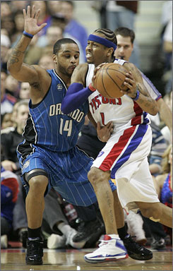 Detroit Pistons guard Allen Iverson, right, works against Orlando Magic guard Jameer Nelson during the first half of their game in Auburn Hills, Mich. Iverson had 15 points, one of five Pistons players who scored in double figures.