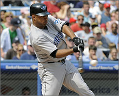 Center fielder  Vernon Wells enters the second year of a seven-year, $126 million contract with the Blue Jays.