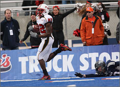 Maryland wide receiver Torrey Smith returns a kick 99-yards for a touchdown against Nevada during the first half of the Humanitarian Bowl in Boise. Maryland knocked of Nevada 42-35.