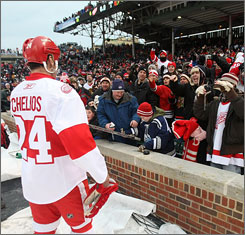 Chris Chelios, a Chicago native and former Blackhawk, greets Wrigley Field fans after the game.