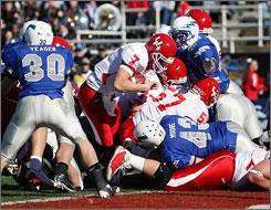 Houston quarterback Case Keenum sneaks for a 1-yard touchdown against Air Force.