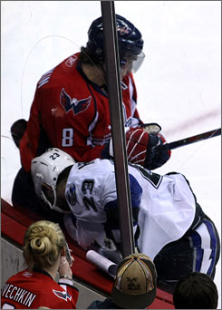 Alex Ovechkin checks former Capitals defenseman Jamie Heward into the boards Thursday, forcing him out of the game.