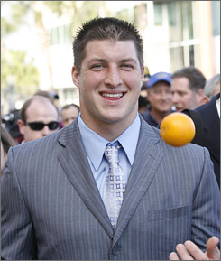 Florida quarterback Tim Tebow tosses an orange after arriving with his Gators teammates in Ft. Lauderdale after a short charter flight from Gainesville. Florida plays Oklahoma in the BCS Championship game on Jan. 8.