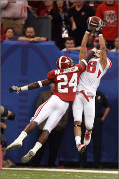 Utah wide receiver David Reed, right, makes a leaping catch over Alabama defensive back Marquis Johnson during the first half of the Sugar Bowl in New Orleans. Reed had 58 receiving yards and a touchdown in the Utes 31-17 win.