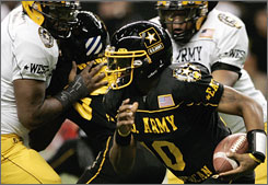 East quarterback Tahj Boyd runs past West defenders during the U.S. Army All-American Bowl at the Alamodome. Boyd, from Phoebus High in Hampton, Va., threw three touchdown passes in the East's 30-17 victory.