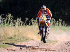 Marc Coma of Spain rides his KTM dirt bike on his way to winning the first stage of the 2009 Dakar Rally between Buenos Aires and Santa Rosa de la Pampa, Argentina.