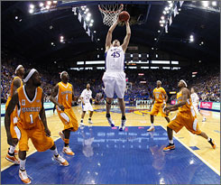 Cole Aldrich slams home two easy points as all five Vols defenders look on during the Jayhawks' upset of No. 18 Tennessee.