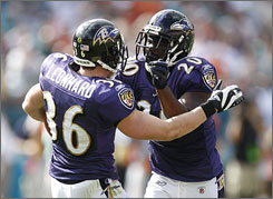Ed Reed, right, had two interceptions off Dolphins QB Chad Pennington on Sunday to power the Ravens' win.