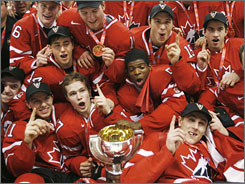 Canadian players celebrate after defeating Sweden 5-1 to win their country's fifth consecutive gold medal at the world junior hockey championships.
