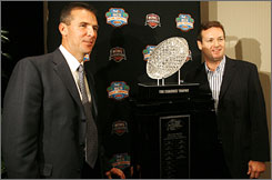 Florida coach Urban Meyer, left, and Oklahoma coach Bob Stoops pose with the Bowl Championship Series trophy after a news conference in Hollywood, Fla., on Dec. 10. Meyer and Stoops are both from Ohio, separated at birth by less than four years and no more than 60 miles.