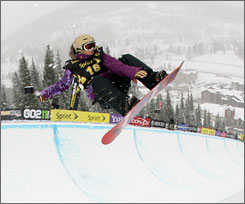 Gretchen Bleiler, above, is atop the women's snowboard superpipe standings on the Alli Winter Dew Tour. Kelly Clark is second.
