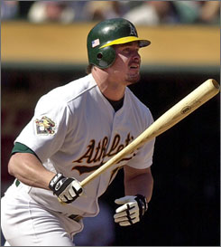 Jason Giambi, seen here in a 2001 photo, began his major league career with the Oakland Athletics and could finish it there as well.