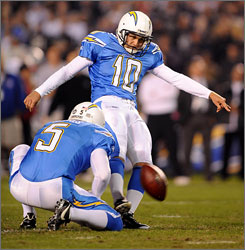 "Chargers punter Mike Scifres, shown holding for a field goal attempt by Nate Kaeding, was a big factor in the team's wild-card win against the Colts. ""He was the difference in the game,"" Indianapolis coach Tony Dungy said. ""He just punted us in the hole all night long."""
