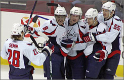 Alex Ovechkin was the only member of the Washington Capitals invited to the All-Star Game later this month in Montreal. Other members of the team are questioning why Nicklas Backstrom (center) and Mike Green (second from right) didn't make the team.