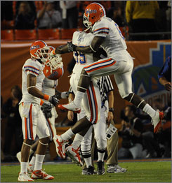 The Florida defense celebrates after stopping Oklahoma on a fourth-and-goal play in the first half. Twice the Gators prevented the Sooners from scoring after driving inside the 10-yard line. 