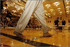IUPUI's Ron Hunter walks in his 2008 barefoot coaching day. This year, more coaches will join him.