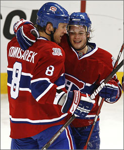 Sergei Kostitsyn receives congratulations from Canadiens teammate Mike Komisarek after scoring the game-winning goal with 21.2 seconds left in Montreal's victory over Washington.