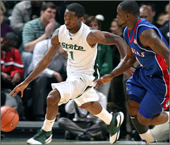 Michigan State's Kalin Lucas, left, lead the way for Michigan State with 22 points in the win against Kansas.