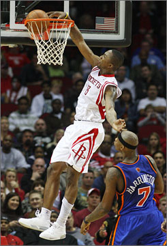 Houston Rockets guard Von Wafer dunks the ball over New York Knicks forward Al Harrington during their game in Houston. Wafer, starting in place of the injured Tracy McGrady, had 15 points and seven rebounds.