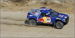 Spanish driver Carlos Sainz powers through the sandy segment from Valparaiso to La Serena, Chile.