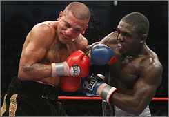 Andre Berto delivers a punch to the face of David Estrada during their NABF welterweight championship fight at Atlantic City's Boardwalk Hall in September. Berto is one of five fighters to watch in 2009.