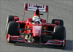 Felipe Massa, the runner-up in last year's drivers' championship, steers the new Ferrari F60 on the Mugello circuit.