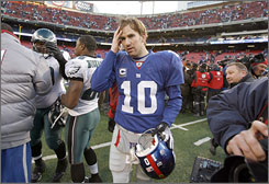 "Eli Manning and the Giants are heading home after being upset in their first playoff game. ""I think 'shock' would be an understatement,"" center Shaun O'Hara said of the team's mood."