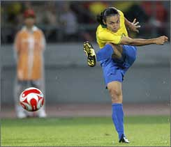 Marta lines up a shot against the USA in Beijing. Los Angeles fans can now cheer for the two-time world player of the year.
