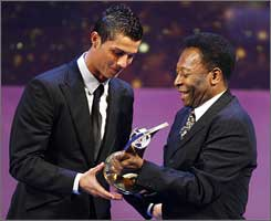 Cristiano Ronaldo accepts player of the year honors from Pele.