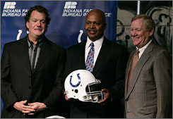 """I am my own person and I suspect that I may be a bit more emotional, at times, than him,"" Jim Caldwell, center, said of replacing Tony Dungy. ""I worked for him for eight years, and I never heard him raise his voice one time, so I might break that record."""
