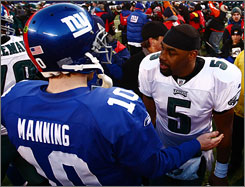 Donovan McNabb, right, and the Eagles ousted top-seeded Eli Manning and the Giants, their NFC East rivals, to set up an unlikely Eagles-Cardinals NFC title game.