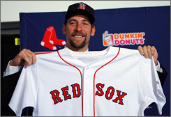 John Smoltz shows off his Red Sox jersey at Tuesday's news conference to announce the signing of his one-year, $5.5 million contract with Boston. If it looks strange, it's because Smoltz spent the first 21 seasons of his career with the Atlanta Braves