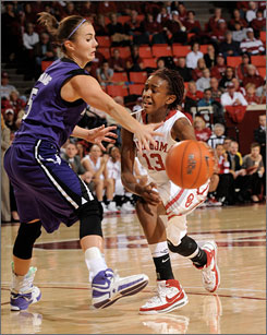 Oklahoma's Danielle Robinson passes the ball around Kansas State's Shalee Lehning as the third-ranked Sooners won their 13th game of the season.