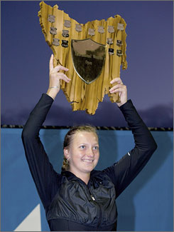 Petra Kvitova proudly displays the Hobart International trophy marking her first WTA tournament crown.