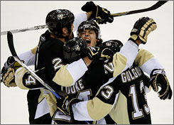 The Penguins celebrate Matt Cooke's first-period goal as Pittsburgh handed Anaheim its fourth loss in five games.