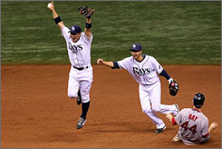Akinori Iwamura, left, and Jason Bartlett, who helped the Rays make a 31-win improvement from 2007, celebrate the final out of the AL Championship Series against the Boston Red Sox.