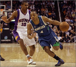 Minnesota Timberwolves guard Randy Foye, right, dribbles around Phoenix Suns guard Leandro Barbosa during the first quarter of their game in Phoenix. Foye scored 15 points as the T-wolves rallied from 11-point third quarter deficit to win 105-103.