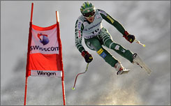 Bode Miller flies past a gate in front of the Silberhorn mountains on his way to a runner-up finish.
