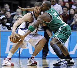 Boston's Glen Davis, right, conks heads with New Jersey center Brook Lopez on a steal attempt during the fourth quarter.
