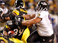 """That boy (Ravens DT Haloti Ngata) is a beast, man, he's a load,"" Steelers RB Willie Parker (39) said of Ngata, right."