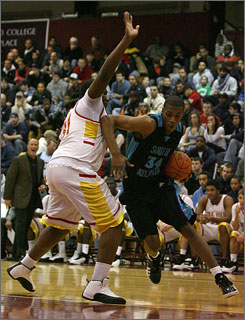 Some lost luggage didn't keep South Atlanta High's Derrick Favors, right, from a solid effort at the Hoophall Classic.