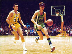 A pair of legendary 44s: The Lakers' Jerry West, left, and the Hawks' Pete Maravich share the court duringa 1971 NBA game in Los Angeles.