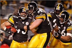 A touchdown by Troy Polamalu after his interception of Ravens QB Joe Flacco clinched the Steelers' berth in the Super Bowl.