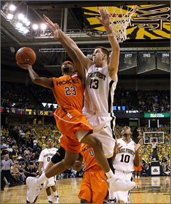 Virginia Tech's Malcolm Delaney, going to the basket against Wake Forest's Chas McFarland, scored 21 points as the Hokies upset the last unbeaten team in Division I.