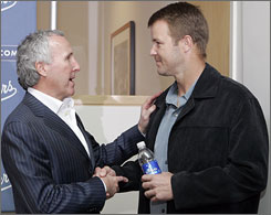 Dodgers owner Frank McCourt, left, wishes Jeff Kent well after the second baseman announced his retirement from baseball after 17 seasons. Kent spent the last four years in Los Angeles after stops with the Toronto Blue Jays, New York Mets, Cleveland Indians, San Francisco Giants and Houston Astros.
