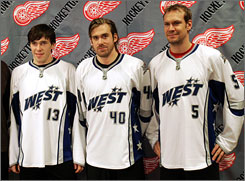 Along with teammate Henrik Zetterberg, center, Red Wings Pavel Datsyuk, left, and Nicklas Lidstrom were All-Stars a year ago when the game was held in Atlanta. Datsyuk and Lidstrom will each be forced to miss a game when the season resumes after backing out of this year's game in Montreal.